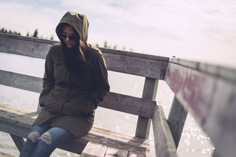 Focus On Foreground Hoodie Jacket Lake Superior Leisure Activity Lifestyles Portrait Railing Sitting Woman Natural Light Portrait