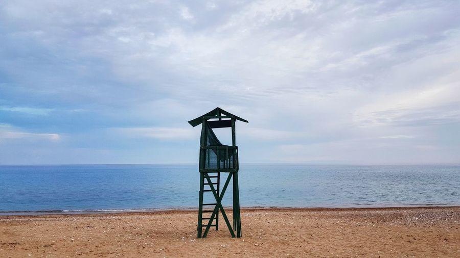 Lifeguard Hut At Komi Beach Against Cloudy Sky
