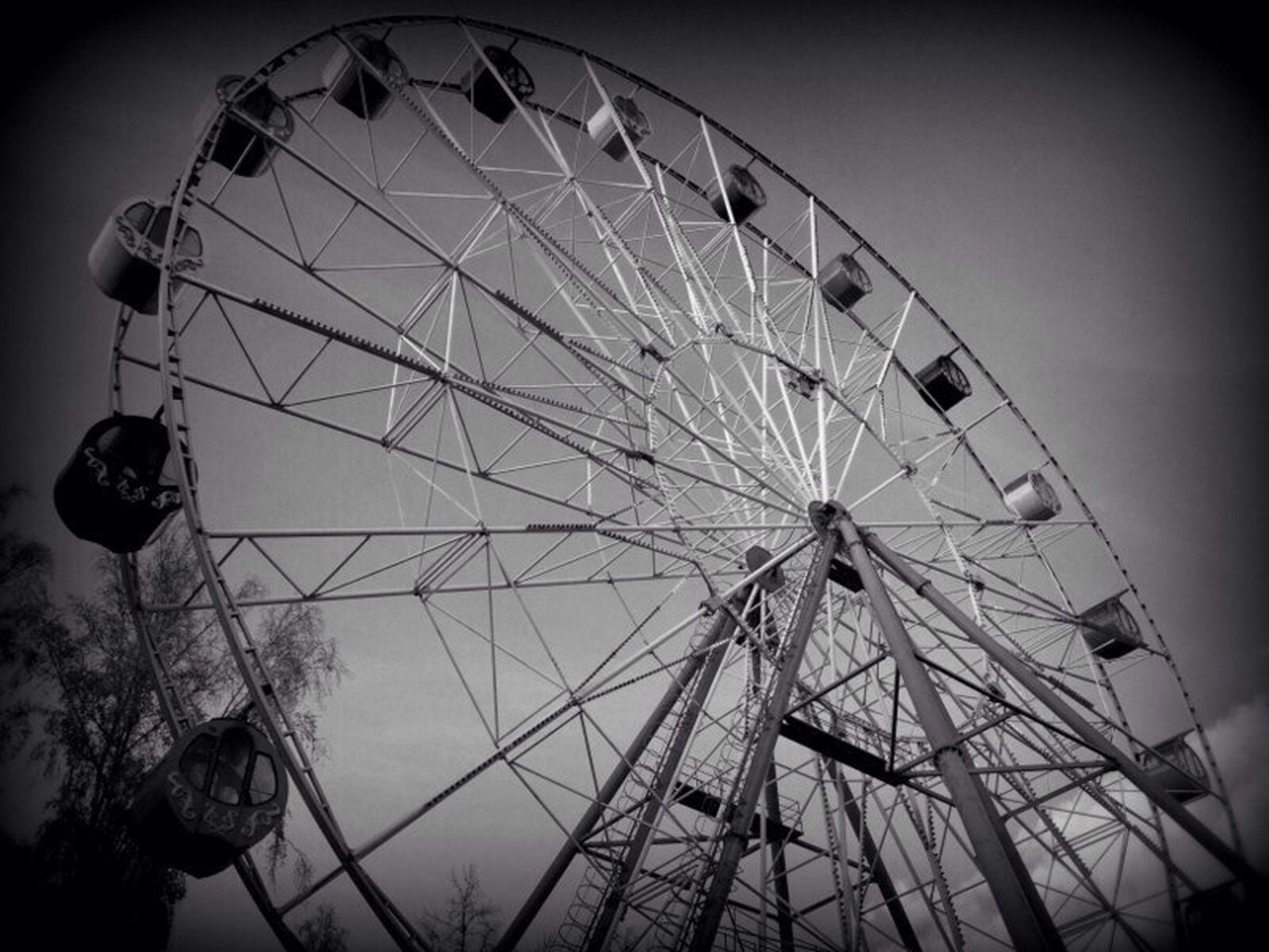 amusement park, amusement park ride, ferris wheel, arts culture and entertainment, low angle view, sky, leisure activity, fun, enjoyment, clear sky, built structure, outdoors, large, day, umbrella, metal, architecture, fairground ride