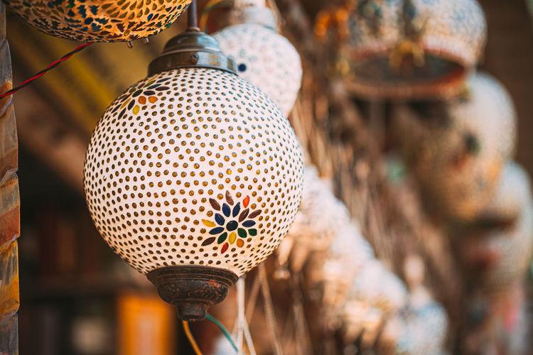 Close-up of lighting equipment hanging in market