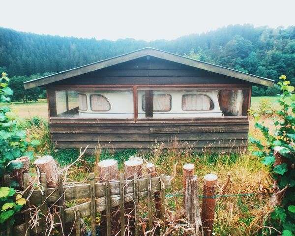 Holiday Ardennes p.10 This is quite common here. Park your caravan and build a house around it. Check This Out Hiking Walking Around Up High Check This Out Caravan Strange Old Shed Surreal Being Adventurous