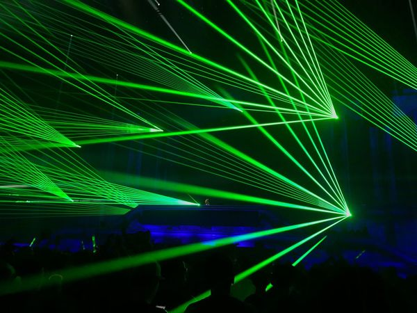 Arts Culture And Entertainment Illuminated Night Nightlife Green Color Laser Enjoyment Real People Multi Colored Youth Culture Fun Lifestyles Nightclub Technology Event Light Effect Stage Light Large Group Of People Indoors  People