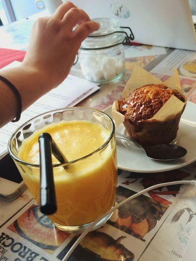 Paris Everyday Lives Having A Break Break Time Orange Juice  Glass Of Juice Muffin Hand Table Setting