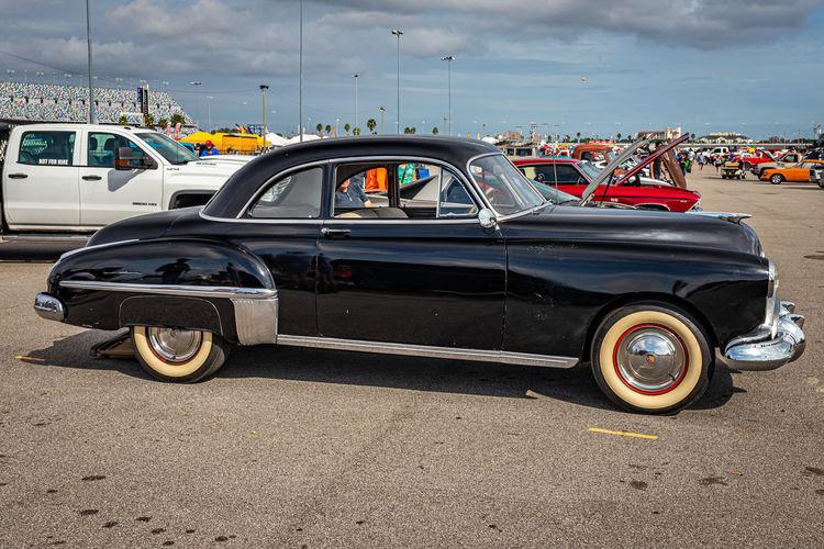Vintage car parked on road