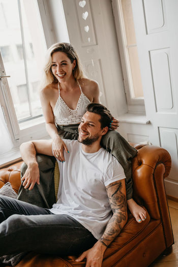 Loving Young Couple Romancing At Home