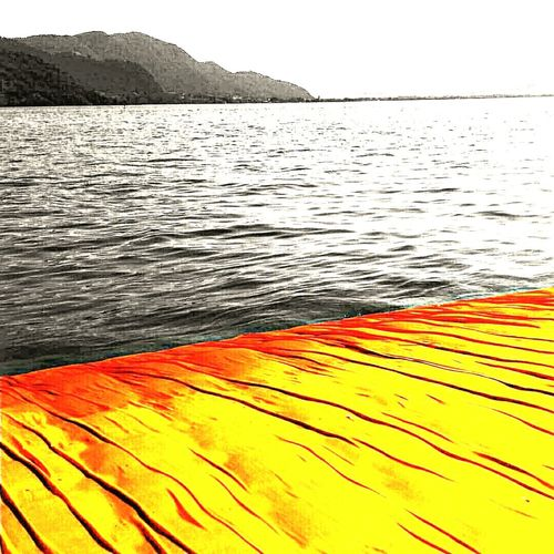 The Floating Piers By Christo Floating On Water Floating Piers Christo Jean Claude Art EyeEm Best Shots EyeEm Best Edits EyeEm Around The World EyeEm Best Shots - Landscape EyeEm Masterclass EyeEm Best Shots - The Streets Black And White With A Splash Of Colour Ee_daily : Orange Tuesday 2016 EyeEm Awards Montisola Monte Isola Sulzano Lake Lake View Different Perspective Different Points Of View EyeEm Best Shots - Sunsets + Sunrise
