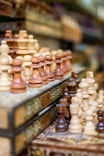 Row of chess pieces on board at store for sale