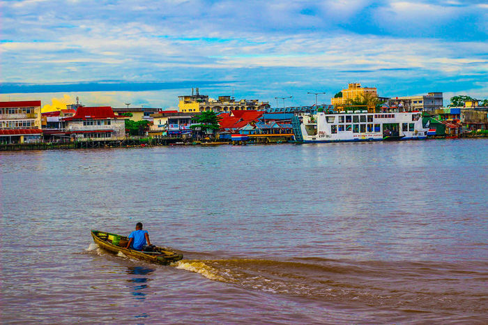 heart of borneo. River Sky Water People Nature Life Transportation Gondola - Traditional Boat One Person Cloud - Sky Day Outdoors Nautical Vessel Real People Khatulistiwa INDONESIA