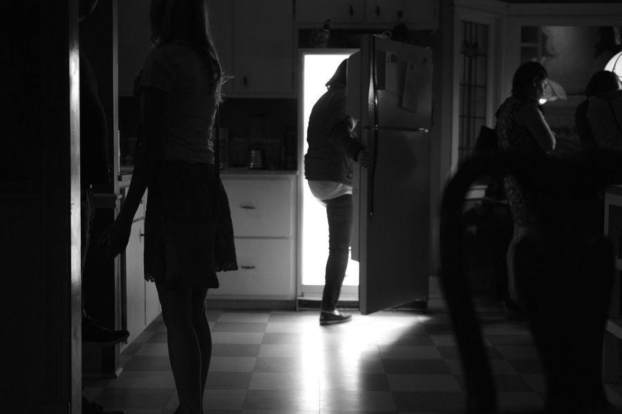 A woman enters a secret passage way at Meow Wolf.