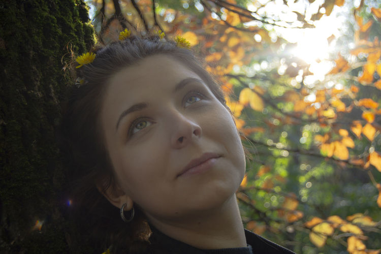 Autumn colors Sunlight Autumn Portrait Beautiful Woman Beauty Beauty In Nature Close-up Contemplation Front View Hairstyle Headshot Leisure Activity Lifestyles Looking Looking Away Nature One Person Outdoors Plant Portrait Real People Tree Women Young Adult Young Women