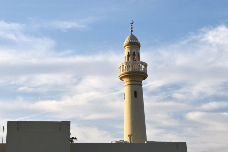 Low Angle View Of Minaret Against Cloudy Sky