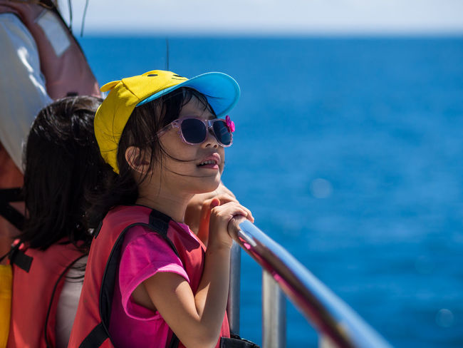Dolphin Watching Adult Child Childhood Day Females Focus On Foreground Horizon Over Water Leisure Activity Lifestyles Mode Of Transportation Nature Nautical Vessel Outdoors People Real People Sea Transportation Two People Water Women