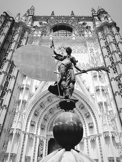"""Giraldillo"" Statue Blackandwhite Photography Sevilla Seville SPAIN Sevilla Spain Andalusia Historical Building España Seville Cathedral Church Catholicism Cathedral Giraldillo Statue Statue Religious Place Blackandwhite Pattern Abstract Sky Close-up"