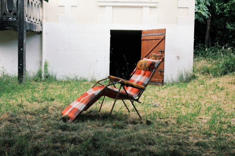 Abandoned chair in field