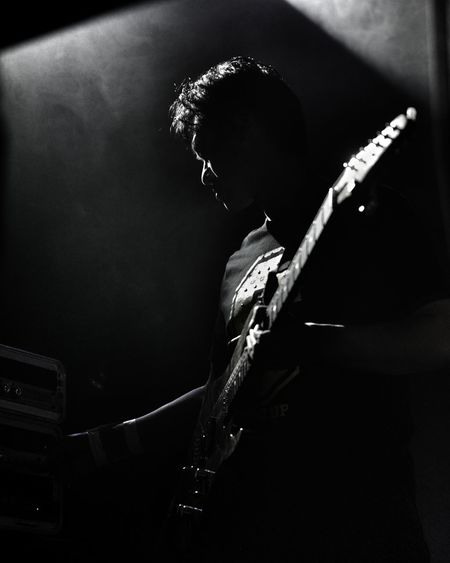 Low angle view of guitarist standing on stage