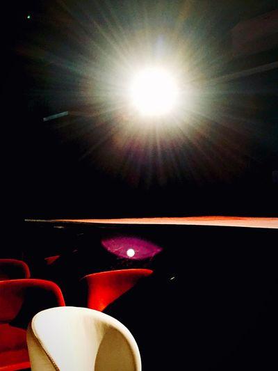 Close-up of illuminated lamp against bright sun