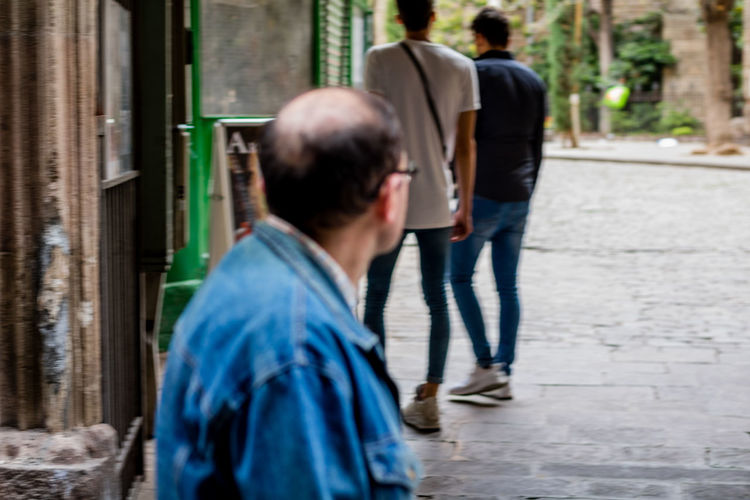 Couriosity Rear View Walking Real People Lifestyles Men Two People Day Outdoors Adults Only People Adult Couriousity One Man Only One Person Portrait Of A City Street Photography Barcelona