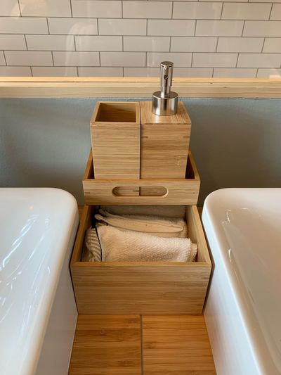 Wooden cabinet between bathroom sinks
