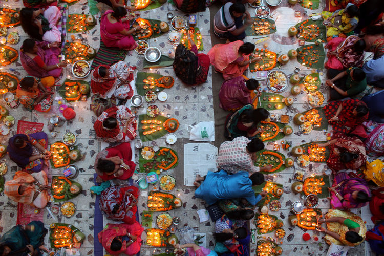 Rakher Upabash is a Hindu religious fasting festival. Hindu devotees light candles and pray in the Baba Laknath temple during the Rakher Upobash. Hindu devotees fast and pray in earnest to the gods for their favors during this ritual. The Great Outdoors - 2018 EyeEm Awards The Street Photographer - 2018 EyeEm Awards Candles Hindu Hinduism Light Abundance Choice Devotees Hindu Ritual Large Group Of Objects Men Multi Colored People Variation Women