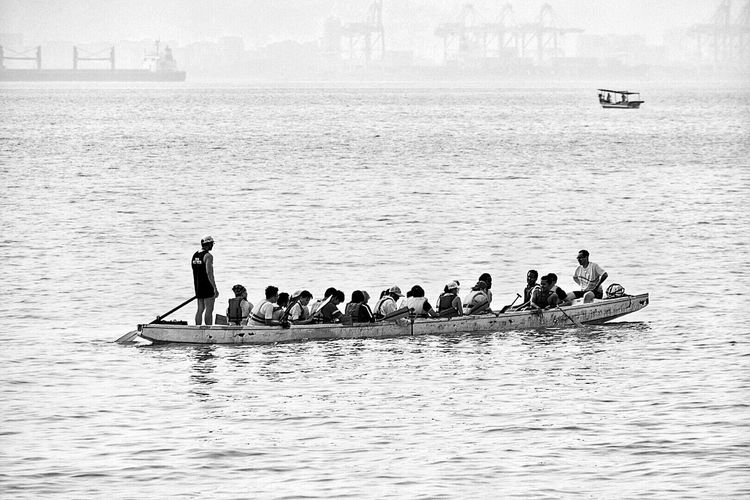 Feel The Journey Dragon Boats Dragon Boat Oarsman Oars In Water Penang Malaysia Malaysia Penang Boat Monochrome Black And White Small Boat Water Sea Sport Water Sports Ocean View Sea And Sky Rowing Paddle ASIA Working Together Group Of People Water Splash Team Work Team Crew Power Monochrome Photography