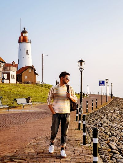 Men Man Sunrise City Tower Mensfashion Urk Flevoland Netherlands Full Length Working Men Standing Sky Casual Clothing Lighthouse Repairman Maintenance Engineer Sustainable Resources Guidance Hands In Pockets Tall - High Wrench