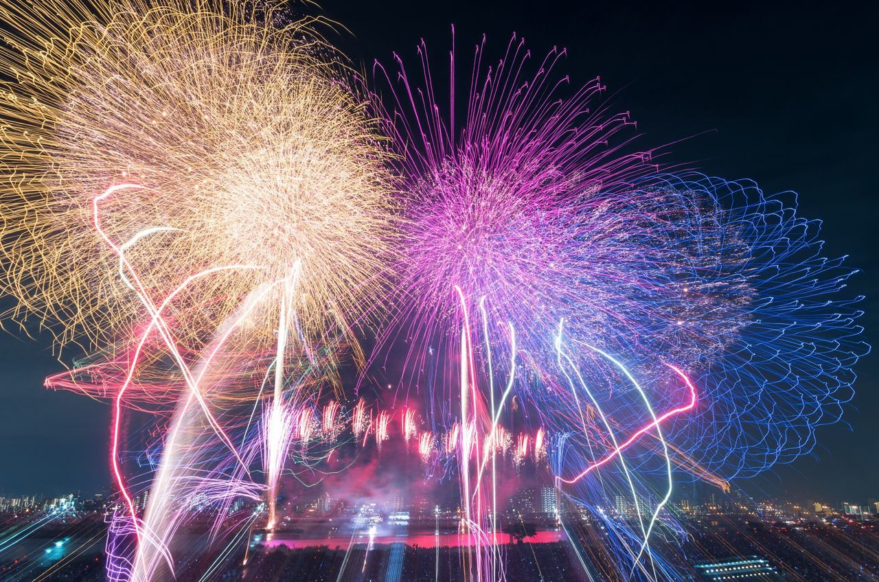 celebration, illuminated, night, long exposure, firework display, firework - man made object, no people, multi colored, arts culture and entertainment, low angle view, outdoors, sky, city