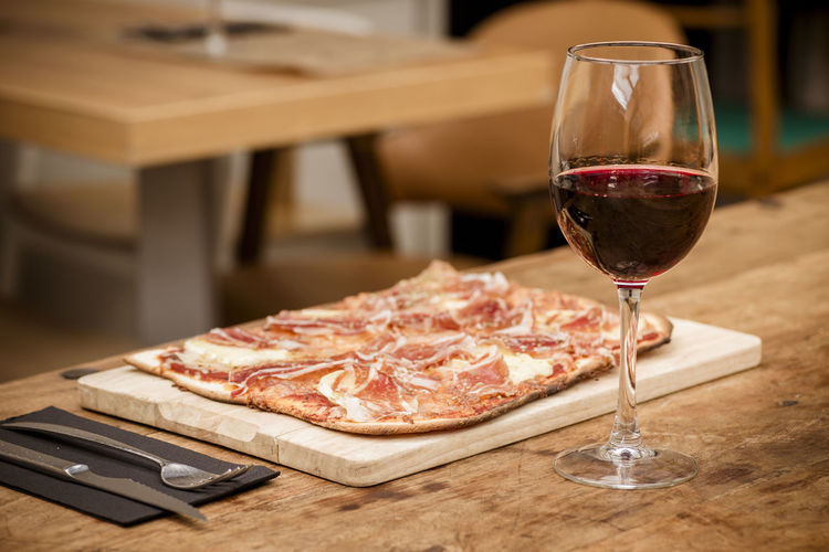 Atmosphere Baket Brie Cheese Cooked Cured Cutlery Drinking Glass Food And Drink Freshness Ham Iberian Food Indoors  Italian Food Knife Pizza Red Wine Restaurant Rustic Table Snack Table Tradidional Wine Wineglass