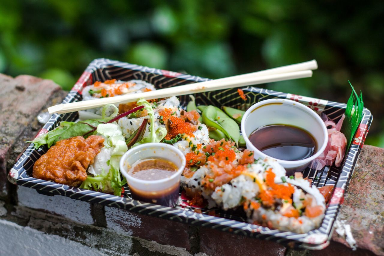 High angle view of sushi in container on wall