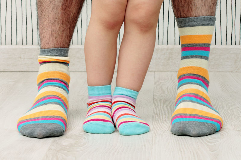 Father and son in stripped socks Family Father Human Body Part Human Leg Indoors  Low Section Multi Colored Sock Son Standing Striped Togetherness