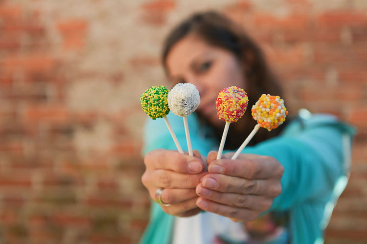 Close-up of woman holding lollipops