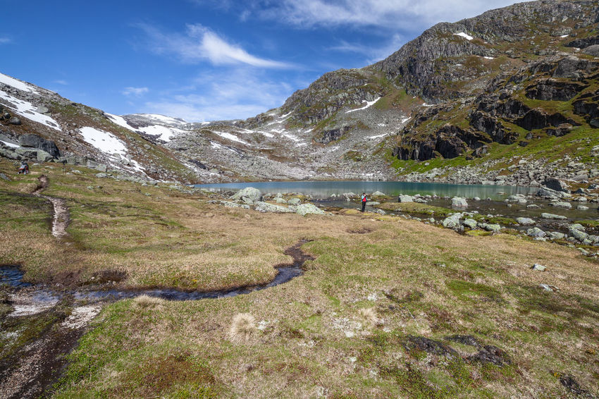 Hiking Norway Beauty In Nature Cloud - Sky Day Environment Hiking Hiking Adventures Incidental People Lake Landscape Mountain Mountain Range Nature Non-urban Scene One Person Outdoors Real People Rock Scenics - Nature Sky Snow Tranquil Scene Tranquility Walking Water