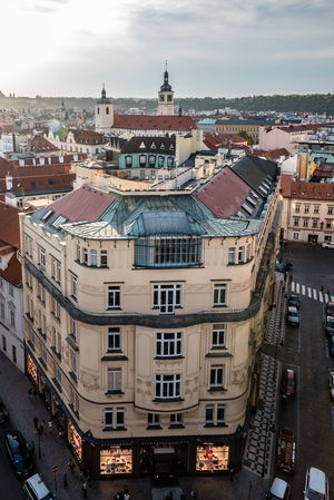High angle view of Prague at sunset Bohemia City City Life Cityscape Czech Czech Republic Prague Travel Apartment Architecture Building Building Exterior Built Structure City City Life Cityscape Cloud - Sky Day High Angle View High Angle View Of Prague Nature No People Outdoors Residential District Roof Sky Street Town TOWNSCAPE Travel Destinations Urban Window