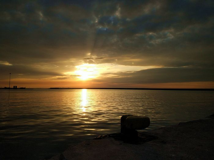 sittin on the dock of the bay... time Alone Time Dusk Sky Pier Beach Beauty In Nature Cloud - Sky Day Dock Of The Bay Horizon Over Water Idilic Scene Nature No People Outdoors Reflection Scenics Sea Silhouette Sky Sun Sunlight Sunset Tranquil Scene Tranquility Water Wharf EyeEmNewHere