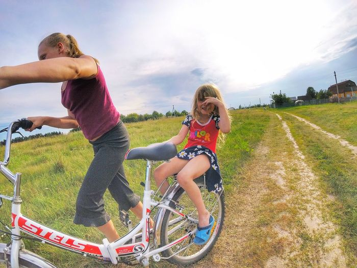 Sisters cycling EyeEmNewHere Kids Summertime Girl Fun Bike Riding Bysicle Summer Sports Friendship Young Women Child Togetherness Childhood Full Length Girls Motion Sibling Sister