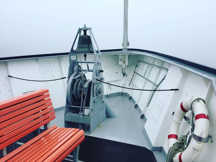 Empty bench with lifebelt in boat
