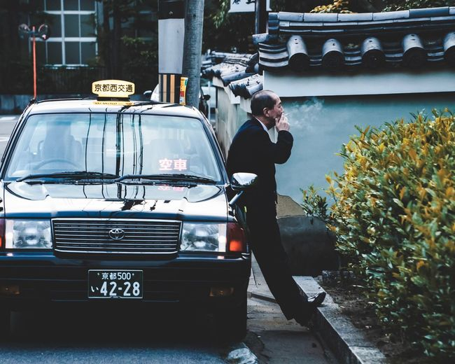 Time For A Smoke Taxi Driver Car Alone Man People Photography People Japan Street Photography Steet Streetphotography Break Smoking Japanese Taxi Cab Driver Taxi Kyoto Japanese Style Japan Photography Japanese Culture