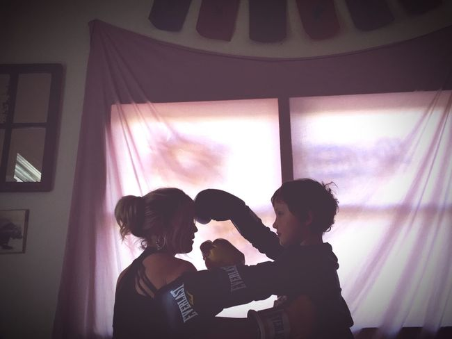 Fight Mom And Son Playing Childhood Kickboxing Two People Real People Window Indoors  Lifestyles Togetherness People Day Eye On The Prize