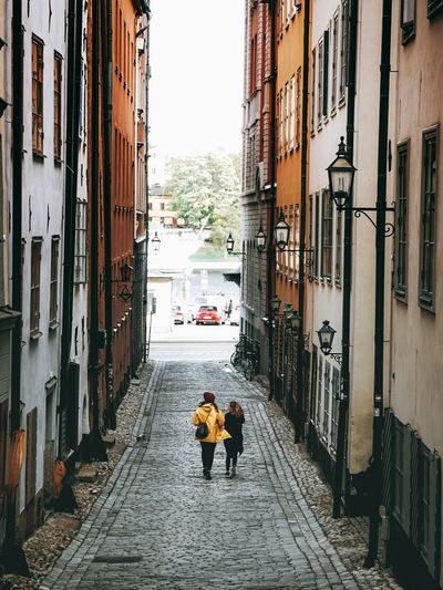 both of us Couple Love Dating Honeymoon Soulmate Walk Journey Romantic Hipster Fashion Yellow Coat Wnter Autumn Old Town Stockholm Gamla Stan City Headwear Men Full Length Hardhat  Occupation Architecture Building Exterior Built Structure Friend Trip Leisure Moving A New Beginning It's About The Journey