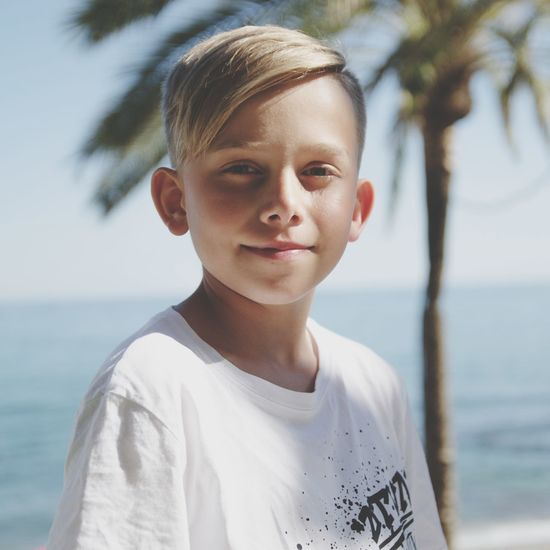 Portrait of boy standing in sea