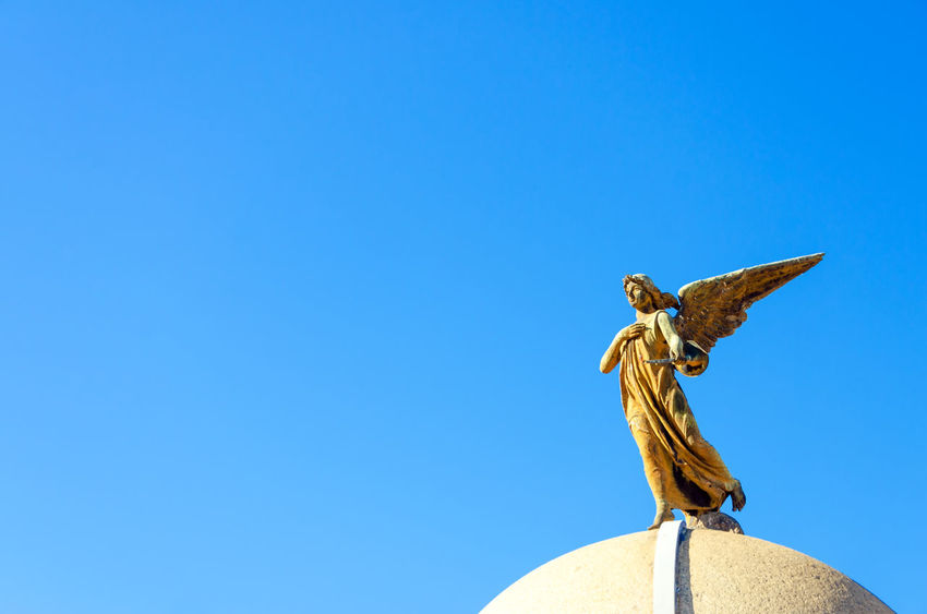 An angel on top of a tomb in the Recoleta Cemetery in Buenos Aires America Angel Argentina Art Buenos Aires Capital Federal Cementery City Death Decor Decoration Face Old Recoleta Recoleta Cemetery Religious  Sacred Sculpture South America Statue Stone Symbol Tango Tourism Travel