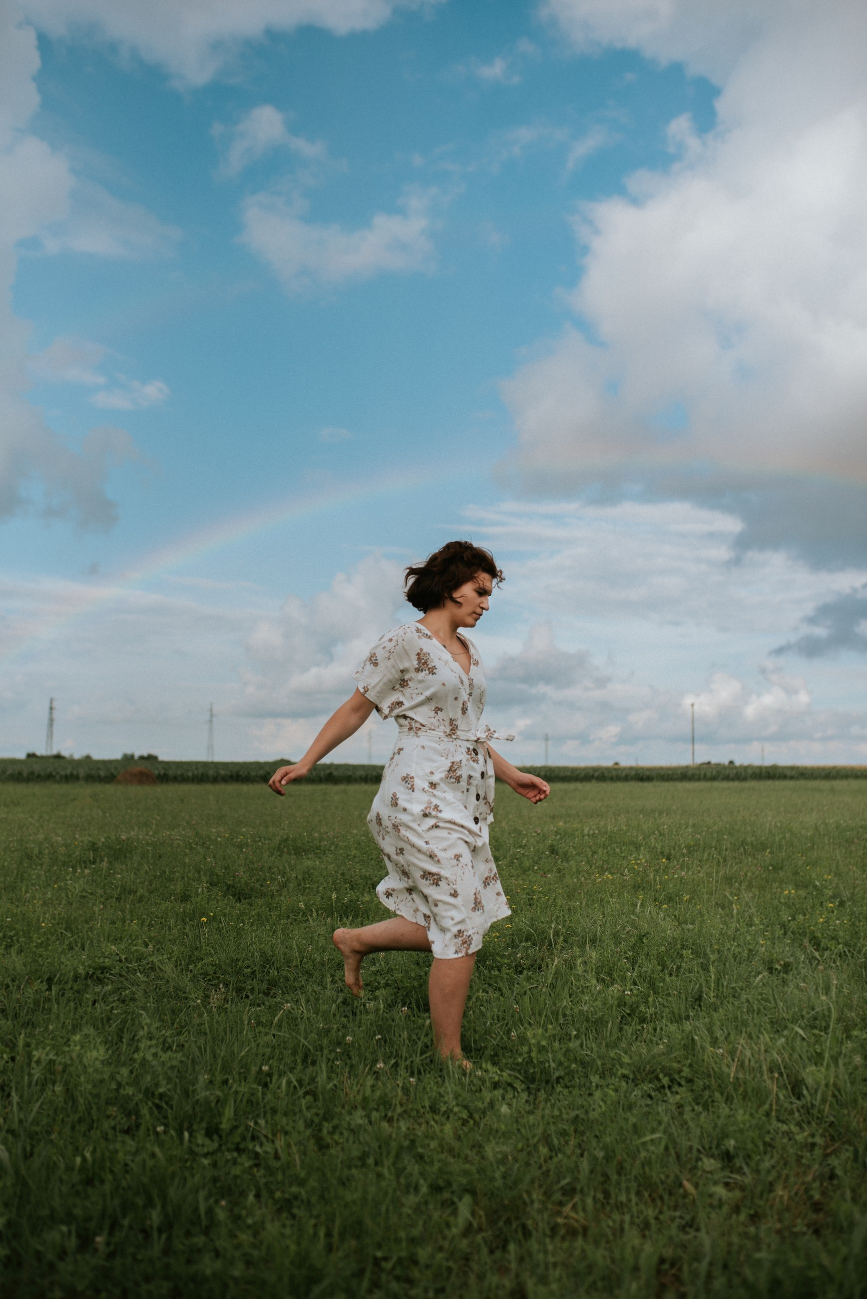 cloud - sky, field, grass, land, sky, one person, full length, plant, women, casual clothing, standing, nature, environment, leisure activity, landscape, running, child, childhood, day, real people, outdoors