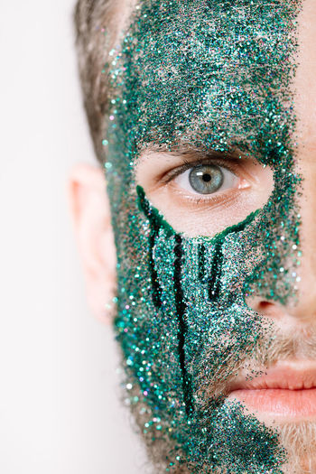 Close-up portrait of man with glitter