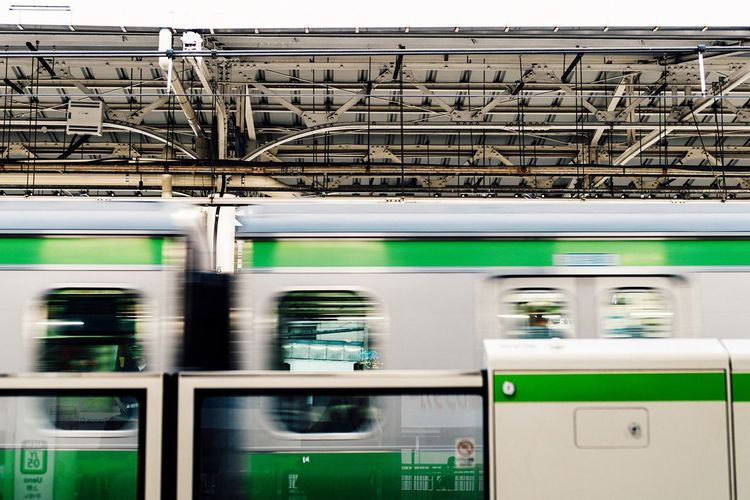 Commuter Train Passing Yamanote Line Metropolis Tokyo,Japan Green Color Mode Of Transport Rail Transportation Station Roof  No People Railroad Station Platform Railroad Station Public Transportation From My Point Of View Passing Through Silver Green Metallic White Roof City Life City Street Tokyo Photography Tokyo August August 2017 Mobility In Mega Cities
