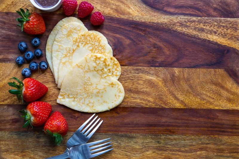 Pancake day Palacinky Coming Soon Making Pancakes Served FeastDay 47 Days Before Easter Sunday Time Of Fasting Shrove Tuesday Traditional Feast Strawberries Raspberries Chocolate Sauce Food Pancakes♥ Pancake Day Pancakes Cutlery Forks Food And Drink Healthy Eating Table Sweet Food Freshness Wood - Material No People Dessert Indoors  Blueberry