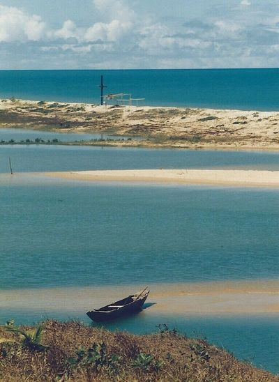 Cahy River river and sea, Prado Bahia 🇧🇷 Sea Tranquil Scene Boat Beauty In Nature Non-urban Scene Scannedphoto Pentax SpII PradoBahiaBrasil