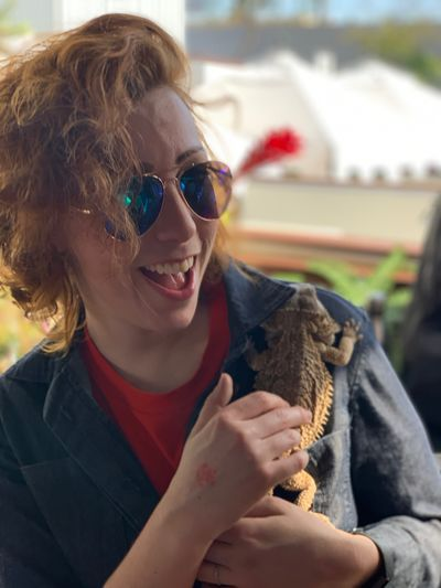 Laughing Aviators Reptiles Lizards Lizard Bearded Dragon EyeEm Selects One Animal Glasses Sunglasses One Person Real People Mammal Domestic Animals Holding Pets Focus On Foreground Smiling Pet Owner Positive Emotion Fashion