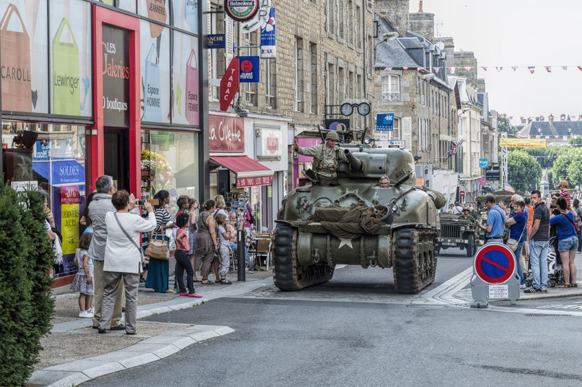 Military parade conmemorating battle of Normandy Architecture Building Exterior Built Structure City City Life Crowd Day Full Length Large Group Of People Lifestyles Men Normandie Normandy Office Building Outdoors Patton Person Road Social Issues Soldier Street Tank Transportation Vehicle World War 2