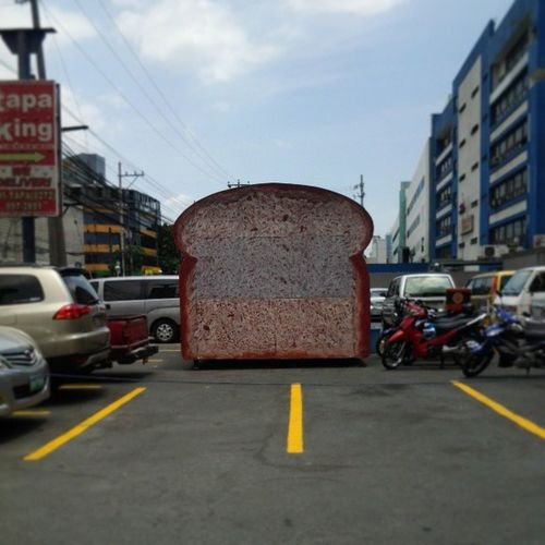 There's a giant loaf bread in the parking lot Antz Lunch Makati