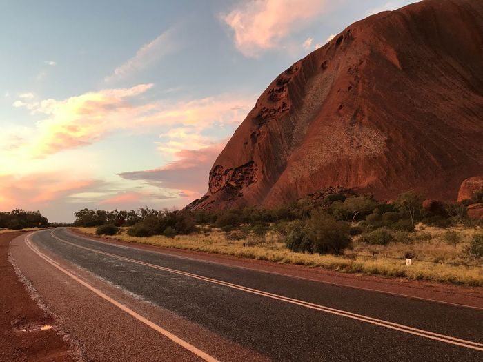 Uluru at sunset, after a brief rain shower EyeEmNewHere Northern Territory, Australia No Filter Uluru Australia Uluru-Kata Tjuta National Park Sky Cloud - Sky Road Nature No People Scenics - Nature Tranquility vanishing point Tranquil Scene Diminishing Perspective Landscape Sunset