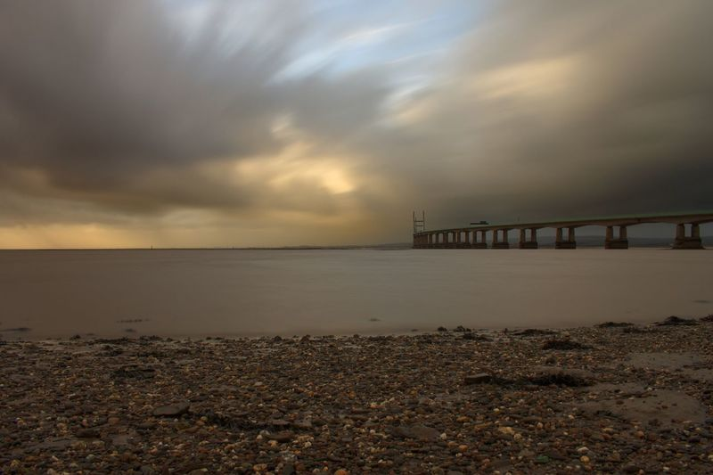 Bridge Bridge - Man Made Structure Long Exposure Sky Sea Cloud - Sky Beach Horizon Over Water Water Nature Sand Sunset Tranquility Outdoors Scenics Built Structure Tranquil Scene Storm Cloud Beauty In Nature No People Architecture